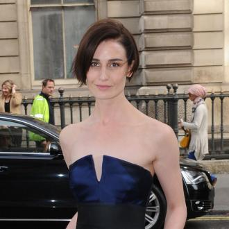 Erin O'Connor practices runway walk in supermarket