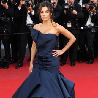 Eva Longoria travels with her pillow