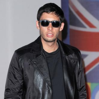 Example wants Professor Green to be godfather