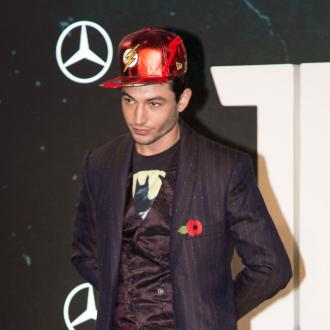 Ezra Miller dubs Zack Snyder the DC god