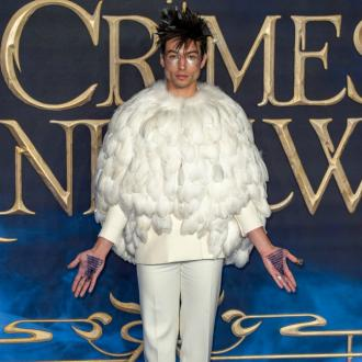 Ezra Miller dresses as Hedwig for Fantastic Beasts premiere