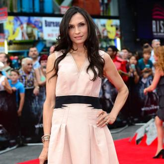 Famke Janssen hits back at Russell Crowe