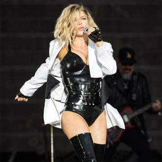 Fergie's back to work tears