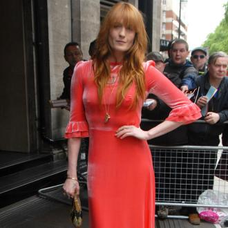 Florence Welch drank to hide from fame