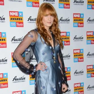 Florence Welch held back from 'dive-bombing' Haim