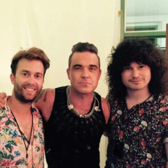 Robbie Williams is forming a new band