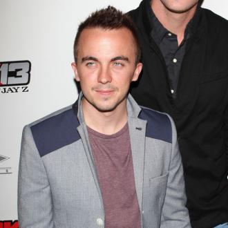 Frankie Muniz In Back Therapy For Dancing With The Stars