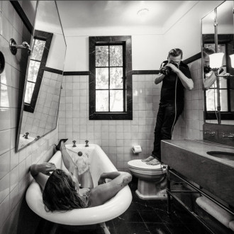 Bryan Adams photographed naked Rita Ora in bathtub for Pirelli Calendar 2022