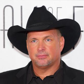 Garth Brooks feels like 'arm candy'