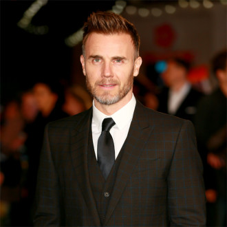 Watch out Chris Martin! Gary Barlow wants to front Coldplay