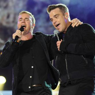 Back For Good? Robbie Williams pens new Take That songs