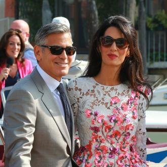George Clooney Feels Like 'Idiot' Talking To Wife Amal