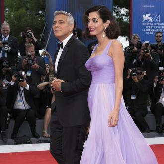 George Clooney says students make him proud to be American