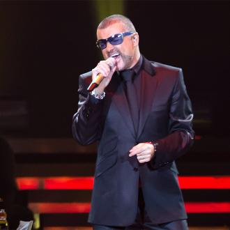 Fans Leave Tributes For George Michael At His Home