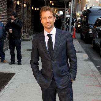 Gerard Butler Gets Distracted In New York