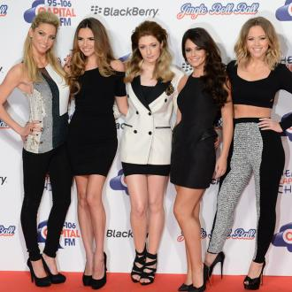 Girls Aloud shouted at fans to buy their songs