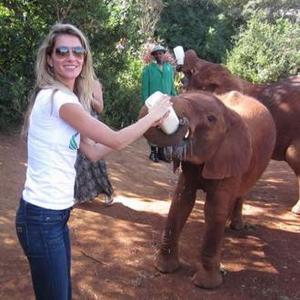 Gisele Bundchen Bonds With Baby Elephants