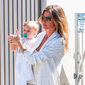 Gisele Bundchen And Tom Brady Baptise Daughter