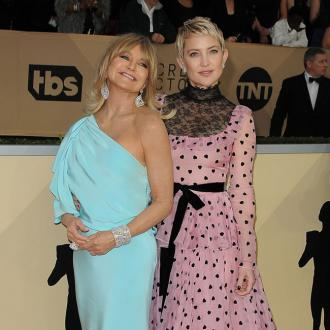 Goldie Hawn swam and ate pizza whilst daughter Kate Hudson gave birth