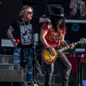 Guns N' Roses deliver the goods with over three hours of hits and covers