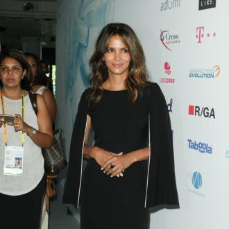 Halle Berry loves being a 'bada**' role model