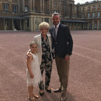 Beckhams receive backlash over Harper's Buckingham Palace tea