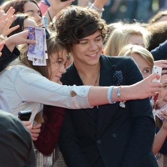 Harry Styles Admits He's 'Too Flirty'