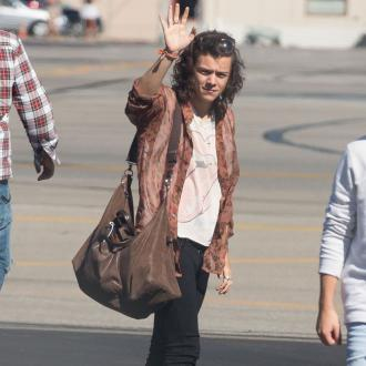Harry Styles Escapes One Direction Drama Through Charity Work