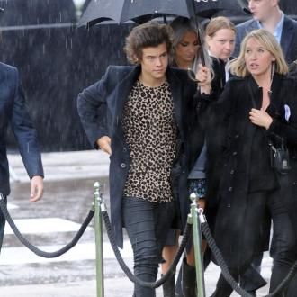 Harry Styles Sits Front Row At Burberry For Lfw