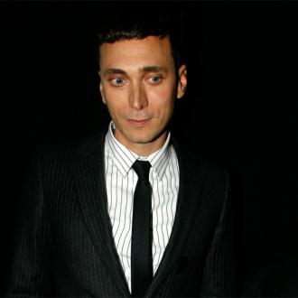 Hedi Slimane Blasts Critic