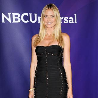 Heidi Klum Ambushed By Topless Protesters