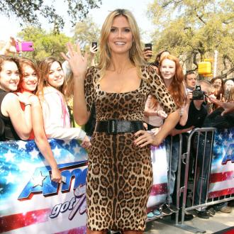 Heidi Klum Having Seal Tattoo Removed