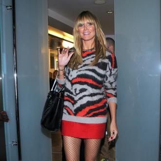 Heidi Klum Sells Designer Clothes For Charity