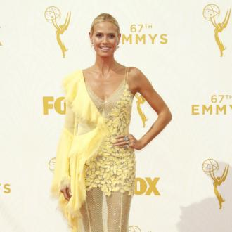Heidi Klum Flashes The Flesh In Yellow Feathery Frock At Emmy Awards