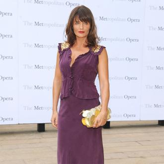 Helena Christensen wears a face mask 'all day' to get youthful looking skin