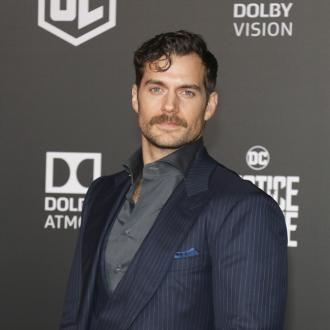 Henry Cavill laps up taking his shirt off on screen
