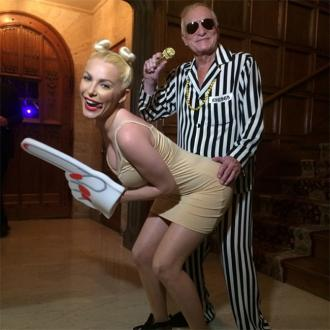 Hugh Hefner and wife dress as Robin Thicke and Miley Cyrus