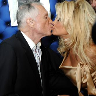Pamela Anderson breaks down in tears in tribute to Hugh Hefner