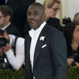 Idris Elba is doting dad