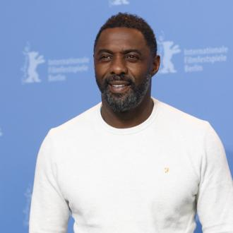 Idris Elba is 'madly in love'