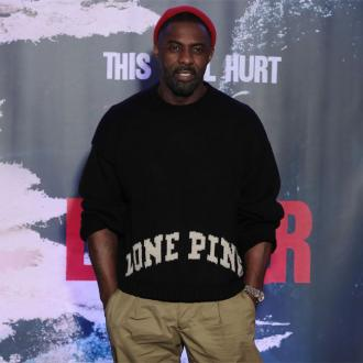 Idris Elba rushes to fitting fan during play