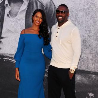 Sabrina Dhowre's Wedding Dress Paid Tribute To Idris Elba