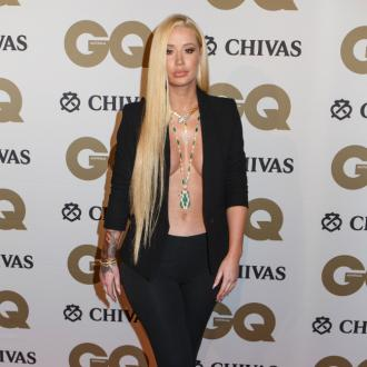Iggy Azalea says feud with Adam Lambert is 'completely entertainment'