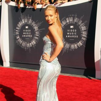 Iggy Azalea Threatens Papa John's With Lawsuit