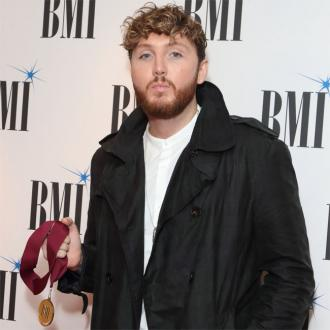 James Arthur vows to shed 2 stone after 'stuffing face' with fake sausage sandwiches and cake