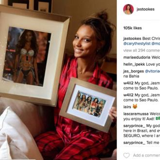 Jasmine Tookes receives framed photos of her in Victoria's Secrets Fashion Show