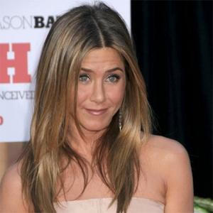 Jennifer Aniston Gets Fluttery About Love