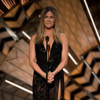 Jennifer Aniston watches TV naked