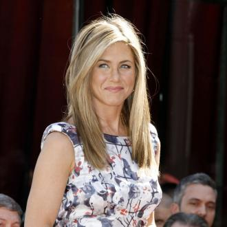 Jennifer Aniston Pokes Fun At Herself With Fake Baby Bump