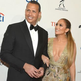 Alex Rodriguez teaches Jennifer Lope about baseball